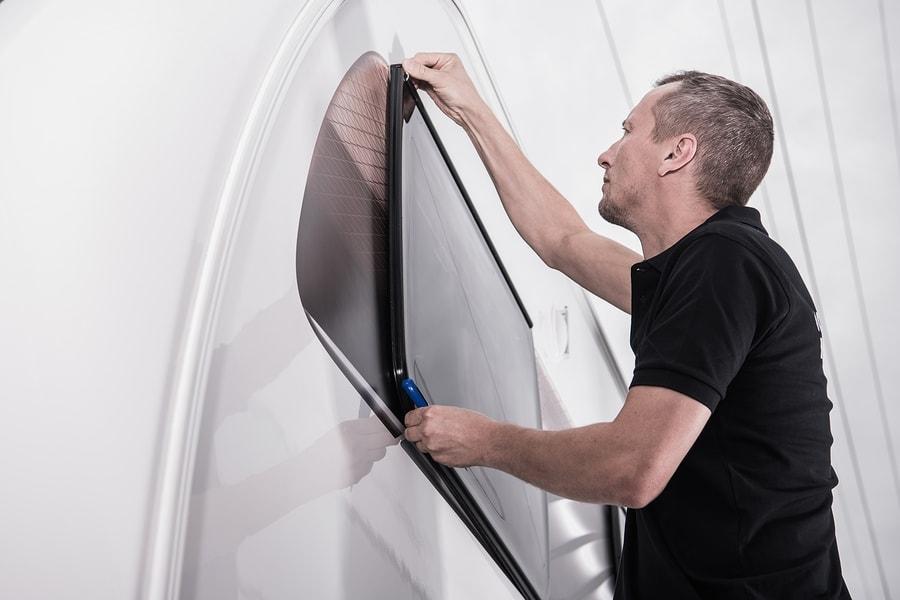 Man sealing an RV window