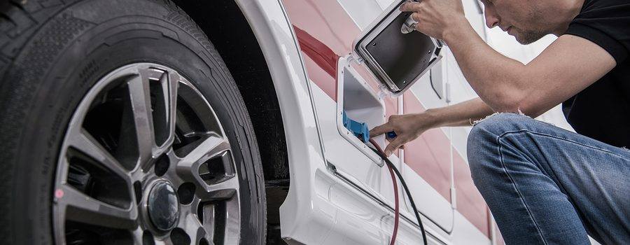 Caucasian Technician Trying To Fix RV Travel Trailer Electric